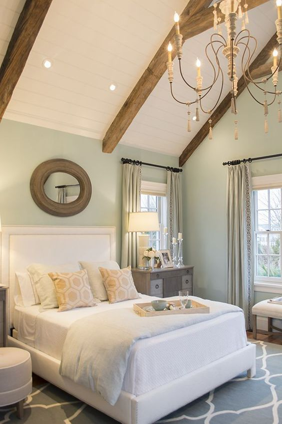 vaulted ceiling with rustic wood beams